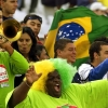 Brazilian football supporters playing music and waving flags