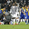 Parma's Amauri leaves the pitch after being shown a red card by referee Luca Banti as Juventus' Giorgio Chiellini lies on the field during their Serie A match at Juventus Stadium on March 26, 2014