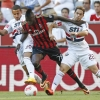 Milan's M'Baye Niang [C] in action with São Paulo's Lucas Evangelista and Silvinho [R] during the Audi Cup Third/Fourth Place Play-Off on August 1, 2013