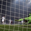 Roma's Kevin Strootman [2nd L] scores a penalty past Milan goalkeeper Gabriel during their Serie A match at San Siro stadium on December 16, 2013