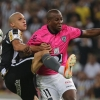 Dória [L] of Botafogo battles for the ball with Armando Solís of Independiente del Valle during their Copa Libertadores match on March 18, 2014