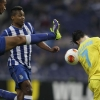 Porto's Danilo [L] and Alex Sandro [C] battle for the ball with Napoli's José Callejón during their UEFA Europa League Round of 16 First Leg at the Estádio do Dragão on March 13, 2014