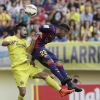 Barcelona's Daniel Alves [R] and Villareal's Jaume Costa jump for the ball during their La Liga match at the El Madrigal on August, 31, 2014