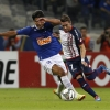 Marcelo Moreno [L] of Cruzeiro and Julio Buffarini of San Lorenzo fight for the ball during their Copa Libertadores quarter-final second leg at Estádio Governador Magalhães Pinto on May 14, 2014