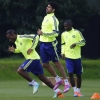 Chelsea's Diego Costa [C] warms up with team-mates Didier Drogba [L] and Ramires during a training session at Cobham Training Centre on September 16, 2014
