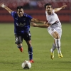Alexandre Pato (R) of São Paulo challenges Esteban González of Huachipato during their Copa Sudamericana match at Estádio Cícero Pompeu de Toledo on 30th September 30, 2014