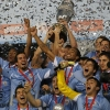 Uruguay's team hold aloft the trophy after they defeated Paraguay in the final of the 43rd Copa América at Estadio Antonio Vespucio Liberti on 24th July, 2011