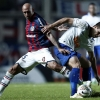 Lucas Silva (L) of Cruzeiro and Juan Mercier of San Lorenzo fight for the ball during their Copa Libertadores quarter-final at Nuevo Gasómetro on 7th May, 2014
