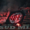 Milan fans light flares during their team's Serie A match against Internazionale at San Siro stadium on 4th May, 2014