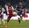 Metz's Modibo Maïga (L) challenges Paris Saint-Germain's Marquinhos during their Ligue 1 match at Stade Saint-Symphorien on 21st November, 2014