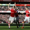 Arsenal's Olivier Giroud celebrates with Gabriel Paulista after scoring the first goal for his side against Everton in the Barclays Premier League at Emirates Stadium on 1st March, 2015