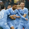 Lazio's Felipe Anderson (C) celebrates after scoring against Roma during their Serie A match at the Stadio Olimpico on 11th January, 2015