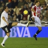 Valencia's Edu (L) and Athletic Club's Joseba Etxeberria fight for the ball during their La Liga match at Mestalla on 2nd December, 2007