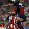 Marquinhos jumps for a ball
