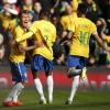 Roberto Firmino celebrates after scoring the first goal for Brazil in their international friendly against Chile at Emirates Stadium on 29th March, 2015
