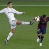 Barcelona's Daniel Alves (R) challenges Real Madrid's Cristiano Ronaldo during their La Liga match at Camp Nou on 22nd March, 2015