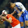 Porto's Casemiro (R) jumps for the ball with Arouca's David Simão during their Primeira Liga match at Estádio do Dragão on 15th March, 2015