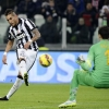 Juventus' Roberto Pereyra scores past Hellas Verona's goalkeeper Rafael during their Serie A match at Juventus Stadium on 18th January, 2015