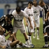 Carlos Alberto (top L) of Botafogo gestures in front of Juan Sebastián Verón (bottom) of Estudiantes de La Plata as team-mates look on during their Copa Sudamericana match at Estádio Olímpico João Havelange on 5th November, 2008