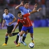 Chile's Alexis Sánchez (front) competes for a ball with Uruguay's Cristian Rodríguez during a friendly match at Estadio Monumental on 18th November, 2014