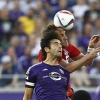 Toronto FC defender Damien Perquis (back) and Orlando City SC midfielder Kaká (front) battle for the ball during the first half of a Major League Soccer match at Orlando Citrus Bowl Stadium on 26th April, 2015