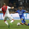 Monaco's Fabinho (L) challenges Juventus' Patrice Evra during their UEFA Champions League quarter-final second leg match at Stade Louis II on 22nd April, 2015