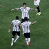 Corinthians' Paolo Guerrero (C) celebrates his goal against Danubio with his team-mates Jádson (R) and Elias during their Copa Libertadores de América match at Arena Corinthians on 1st April, 2015