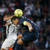 Paris Saint-Germain's Thiago Silva (R) challenges Guingamp's Christophe Mandanne during their Ligue 1 match at Parc des Princes on 8th May, 2015