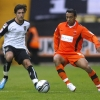 Notts County's Alan Sheehan (L) in action against Hartlepool United's Nolberto Solano during their League One match at Meadow Lane, on 9th October, 2011