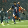 Paris Saint-Germain's Thiago Motta (front) jumps for the ball next to Lorient's Jordan Ayew during their Ligue 1 match at Parc des Princes on 20th March, 2015
