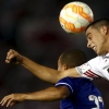 River Plate's Ramiro Funes Mori (R) and Cruzeiro's Mayke fight for the ball during their Copa Libertadores de América quarter-final first leg match at Estadio Antonio Vespucio Liberti on 21st May, 2015