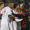 Bayern Munich's Jérôme Boateng (2L) argues with Shakhtar Donetsk's Fernando (R) during their UEFA Champions League match at Arena Lviv on 17th February, 2015