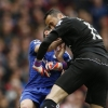 Chelsea's Oscar collides with Arsenal's David Ospina after shooting at goal during Premier League match at Emirates Stadium on 26th April, 2015
